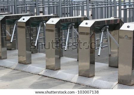Modern nickel-plated turnstile rows - stock photo