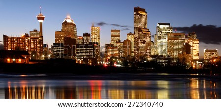 Modern night time shot of downtown skyline full of skyscrapers - Calgary, Alberta Canada. - stock photo