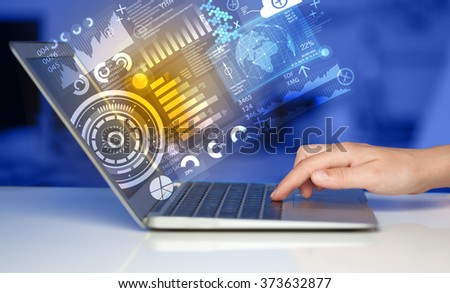 Modern notebook computer with future technology media symbols