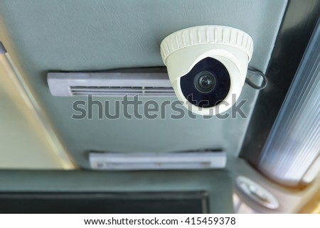 Modern of Security CCTV camera inside bus. - stock photo
