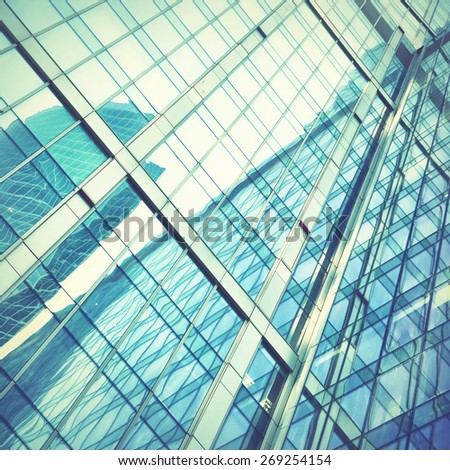 Modern office building - architectural and business background. Retro style filtred image - stock photo