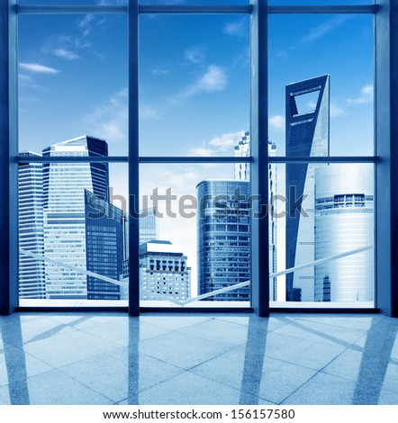 Modern office building both inside and outside the window. - stock photo