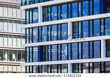 Modern office building detail with transparent glass wall