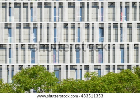 office facade. Modern Office Building Facade Throw Some Trees. Architecture Background.