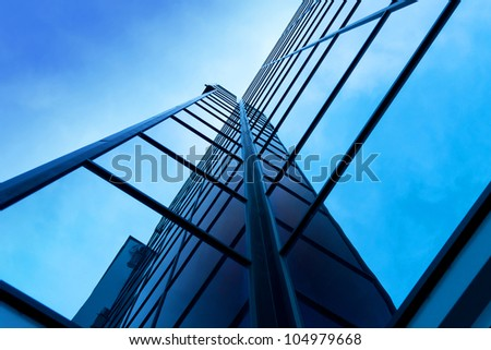 Modern office building on a clear sky background - stock photo