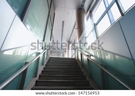 Modern office building stairway glass with windows