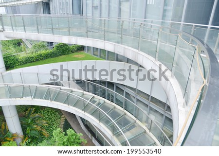 Modern office building with curving staircase an corridor.