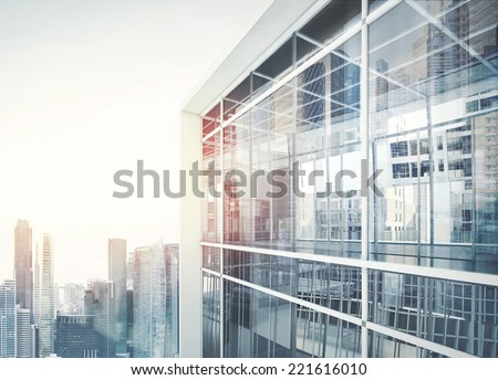Modern office building with facade of glass - stock photo