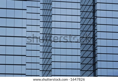 modern office building with glass exterior, wide orientation