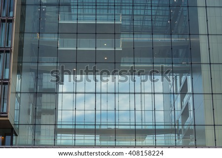 Modern office building with glass facade - stock photo