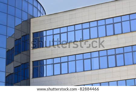 Modern office building with glass windows. Corporate background. - stock photo