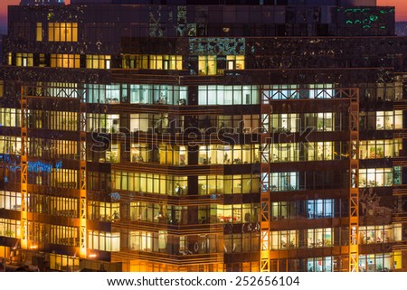 Modern office building with glowing windows at night