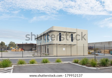 Modern Office Building With Industrial Warehouse And Workshop On The Rear  Plan