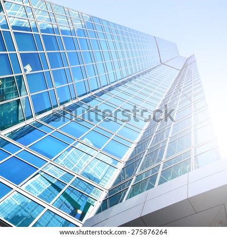 Modern office building with reflections - stock photo