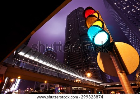 Modern office buildings and traffic lights in Hong Kong - stock photo