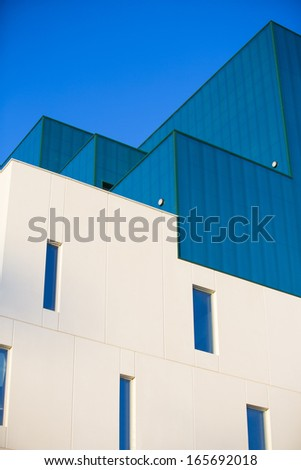 Modern office buildings. Colorful buildings in a industrial place. Vertical format.