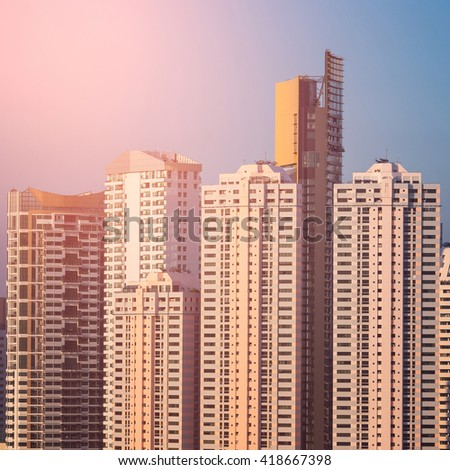 Modern office buildings, condominium high rise and low rise in big city downtown with sunset sky - stock photo
