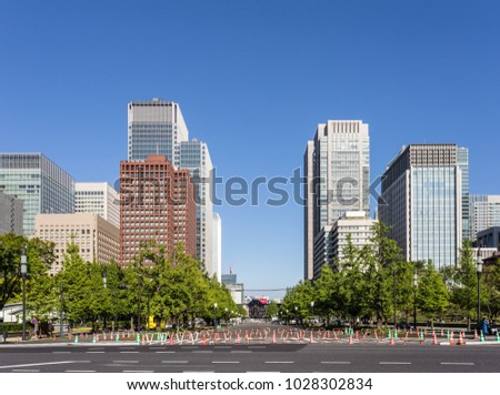 Modern office buildings in the buisiness district of Marunouchi in the heart of  Tokyo in Japan capital city on a sunny summer day