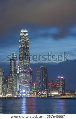 Modern office buildings in Victoria Harbor of Hong Kong at dusk