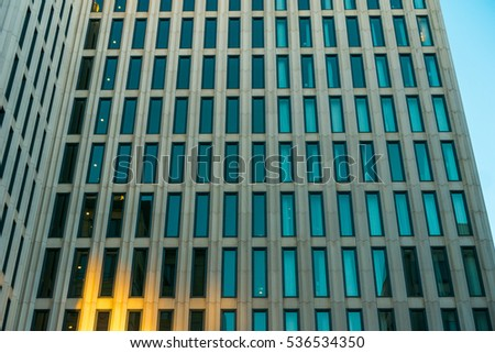 modern office facade with sun reflections on the ground