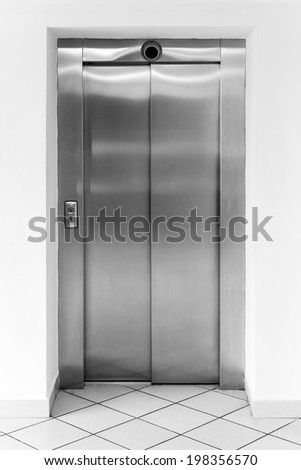 Modern office fragment, shining metal elevator doors