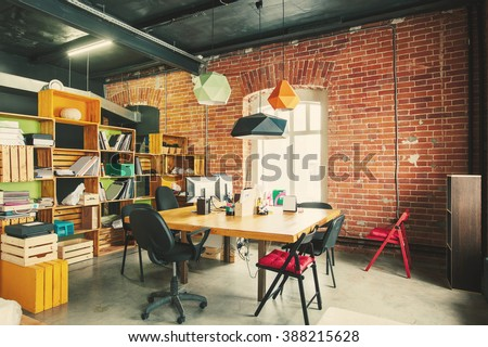 Modern office Interior with old vintage brick Wall. Art work business space - stock photo