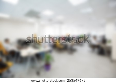 modern office interior with table and desk blurred for logo input - stock photo