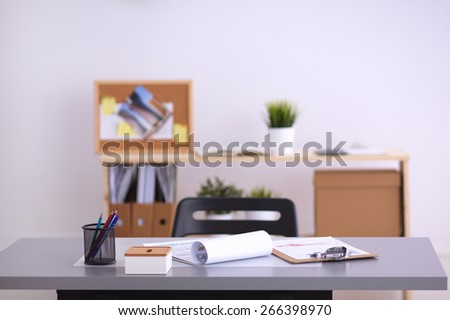 Modern office interior with tables, chairs and bookcases. - stock photo