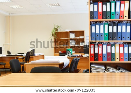Modern office interior with tables, chairs and bookcases. Nobody