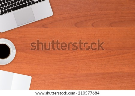 Modern office table with work equipments, coffee, laptop, note book. - stock photo