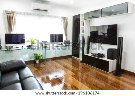 Modern office with computer and labtop with home theater - stock photo