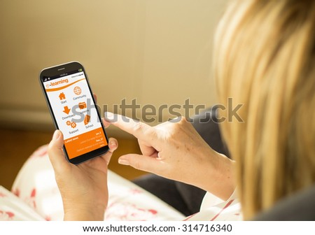modern online learning concept: mature woman with 3d generated touchscreen smartphone with e-learning platform on the screen. Screen graphics are made up. - stock photo