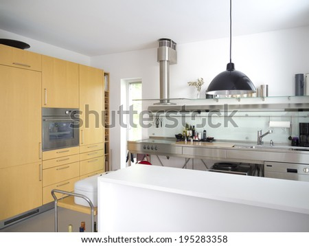 modern open kitchen or pantry interior with stainless steel furniture - stock photo