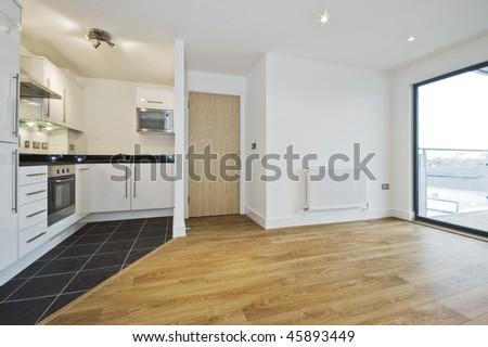 modern open plan apartment with smart kitchen - stock photo