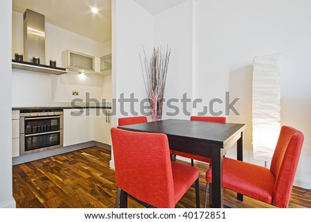 modern open plan kitchen with dining area - stock photo