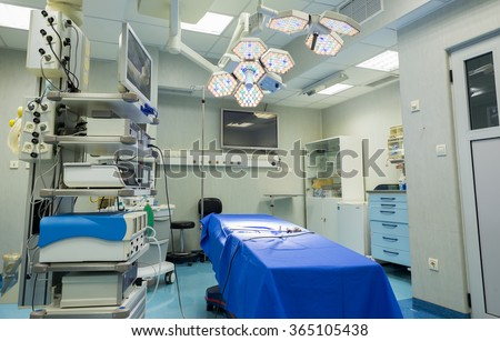 Modern operating room with surgery table, effective lights and life support systems in a stomach and entrails clinic, Sofia, Bulgaria, January 15, 2016.