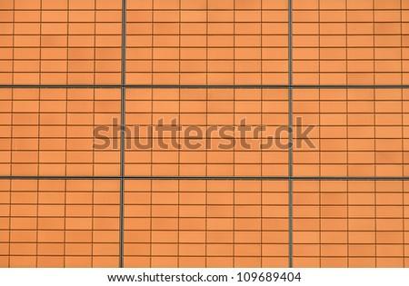 Modern orange facade - stock photo