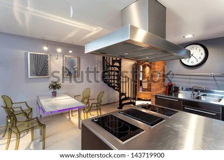 Modern original kitchen and dining room interior - stock photo