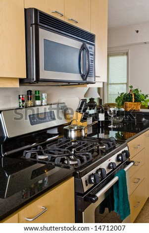 Modern oven and cooktop in a contemporary style kitchen - stock photo
