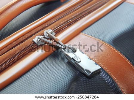 modern padlock closeup on brown suitcase - stock photo