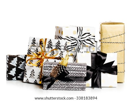 Modern painted paper black and white presents wrap with  bow isolated - stock photo