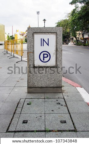 Modern parking sign on the pavement of urban street. - stock photo