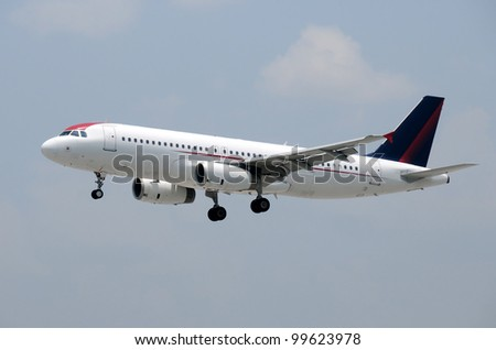 Modern passenger jet in flight - stock photo