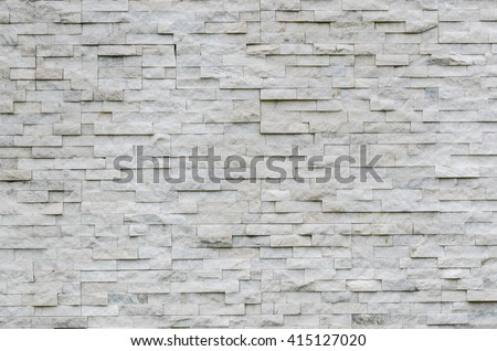 modern pattern of real stone wall decorative surface - stock photo