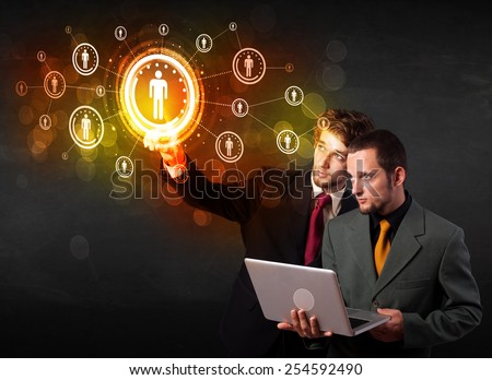 Modern people touching future technology social network button  - stock photo