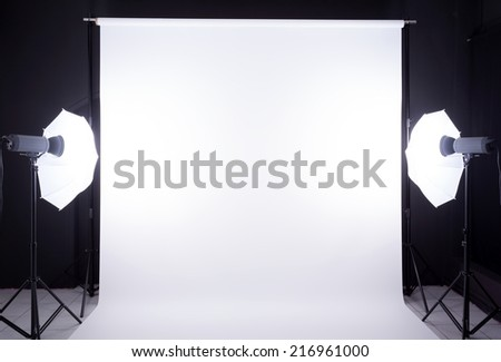 Modern photo studio with lighting equipment - stock photo