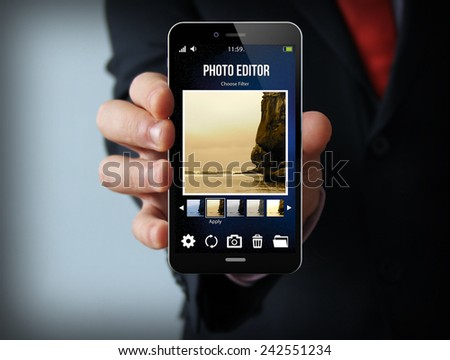 modern photography concept: businessman holding a photo editor smartphone - stock photo