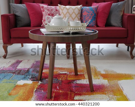Modern pillow and cafe table beautiful home interior design details - stock photo