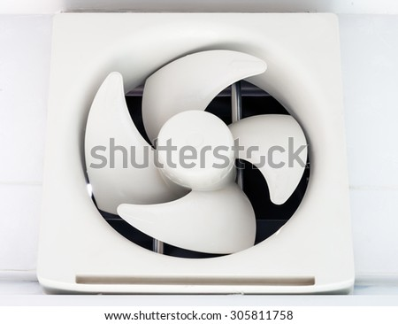 Modern plastic ventilation on the kitchen wall. - stock photo