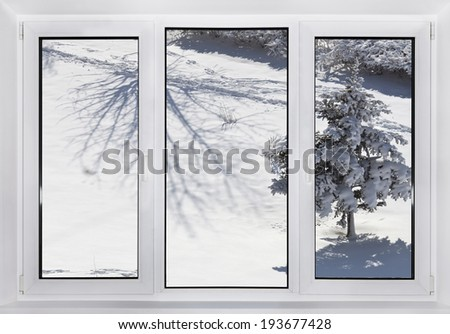 Modern plastic Windows. Winter outside. - stock photo